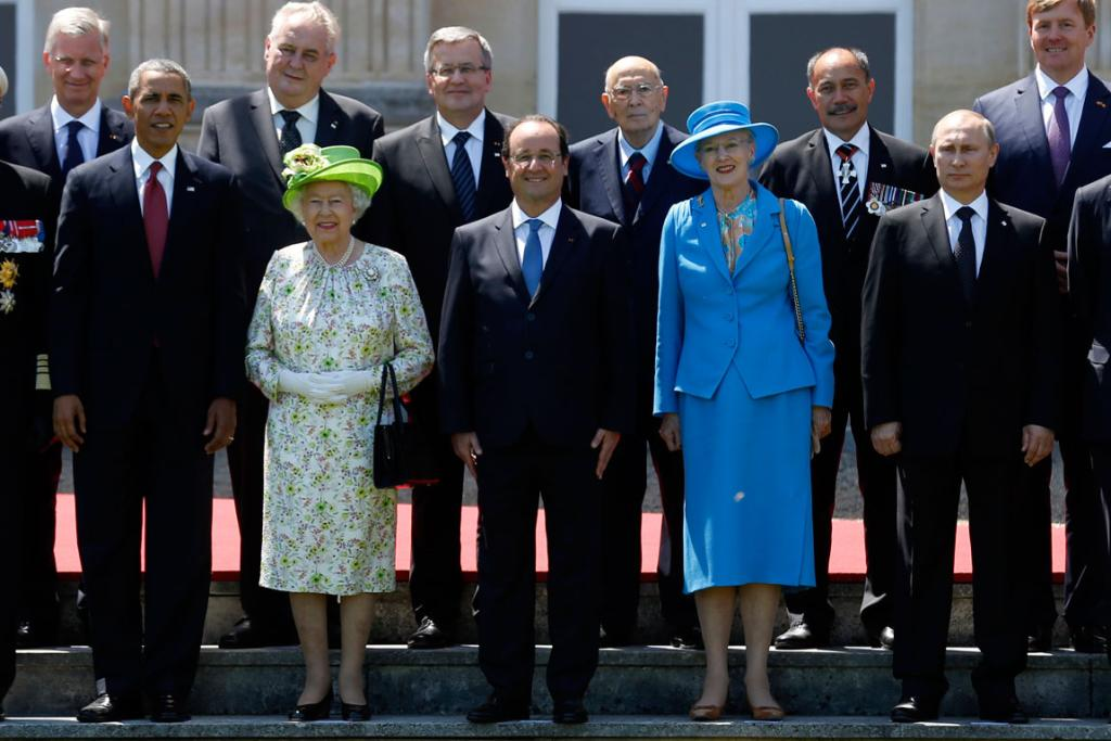THE LINEUP: Barack Obama and Vladimir Putin were separated in the formal photos by Queen Elizabeth II, French President Francois Hollande and Denmark's Queen Margrethe II.