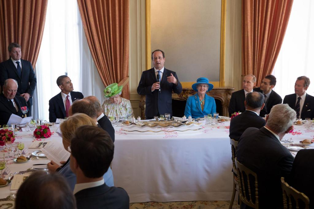 FORMALITIES: World leaders each found a different point of interest in the dining room while French President Francois Hollande gave his speech.