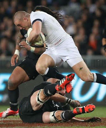 KIWIS SURPRISED: Classy England fullback Mike Brown tramples on a sprawling All Black captain Richie McCaw.