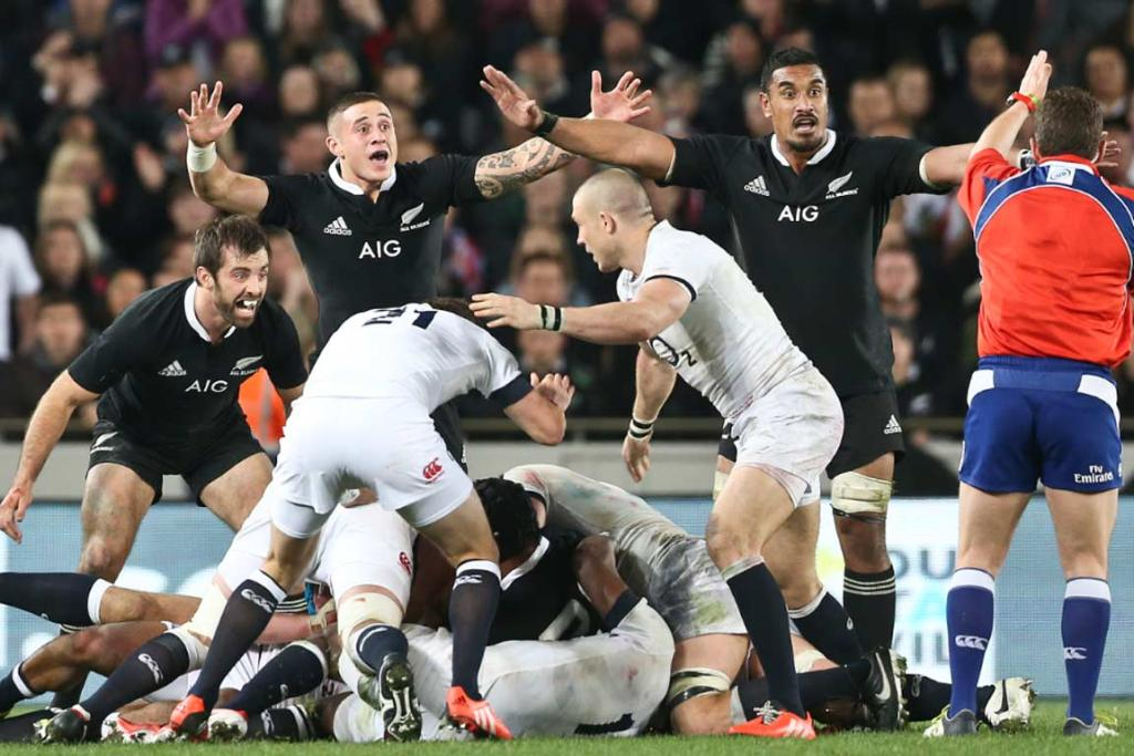 All Blacks Conrad Smith, TJ Perenara and Jerome Kaino appeal to the referee to blow the final whistle.