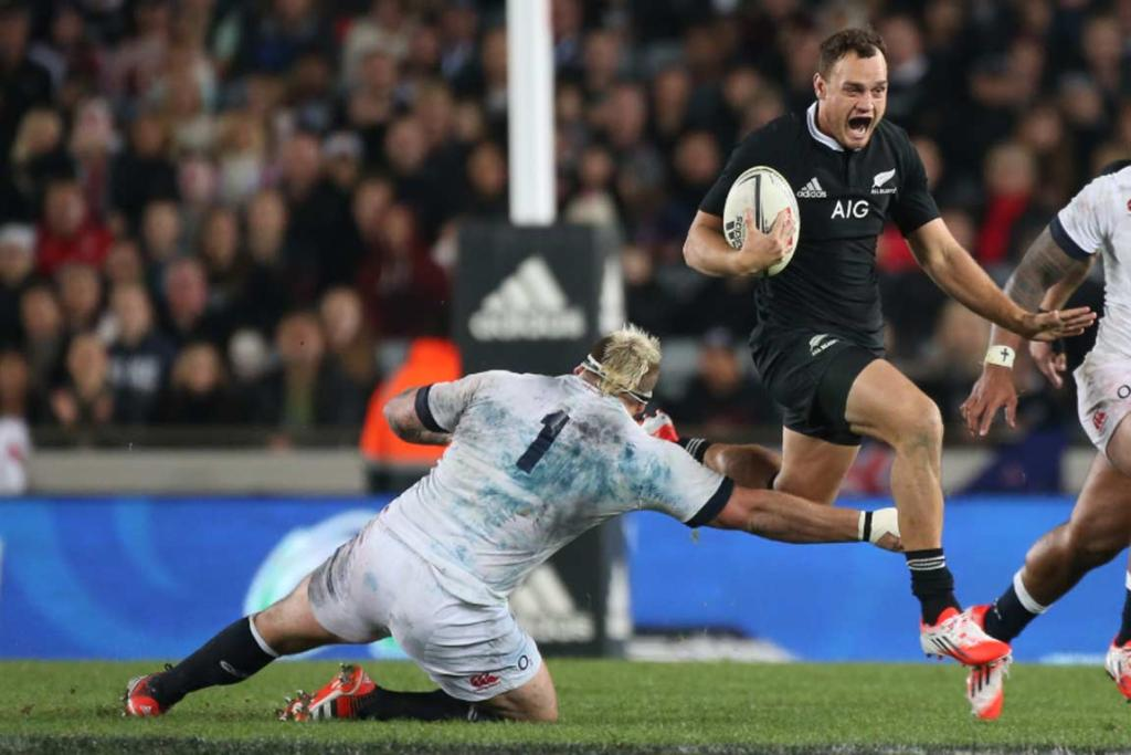 Fullback Israel Dagg evades one England tackle as he runs the ball back.