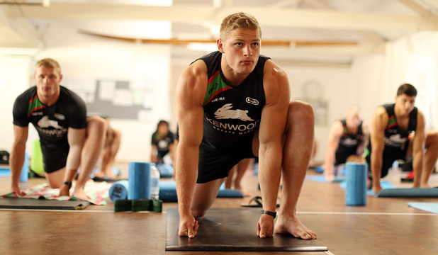 BENDY BOYS: The South Sydney Rabbitohs mid-yoga session. Maybe this sort of balance and stamina training has something to do with the 28 unanswered second-half points they served the Warriors over the weekend.