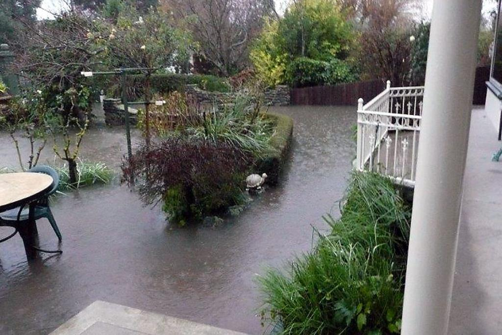 GARDEN UNDER FLOOD: High St, Rangiora property has up to 800mm of water. Owner Kay Galey suspects new West Rangiora subdivisions mean the drainage system can no longer cope.
