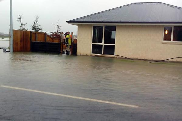 Water laps at Rangiora house
