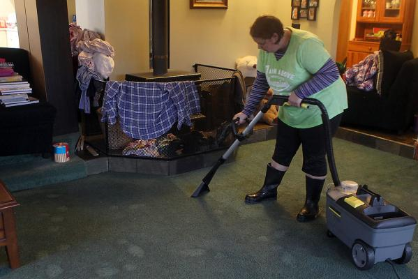 Amy Crowe begins the task of drying the carpet