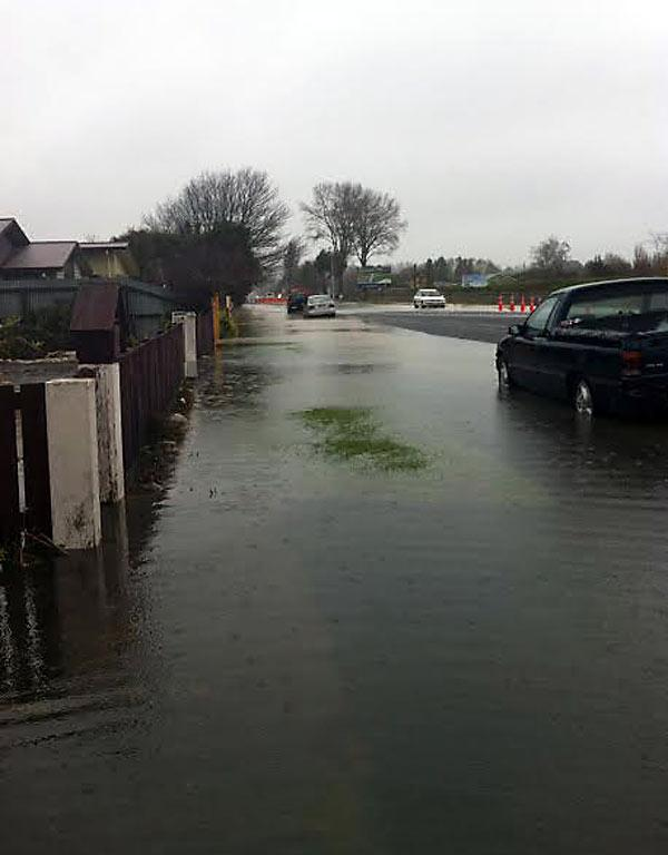 TROUBLE GETTING TO YOUR DOOR: Water pools up around the pavement in Island Rd in Kaiapoi.