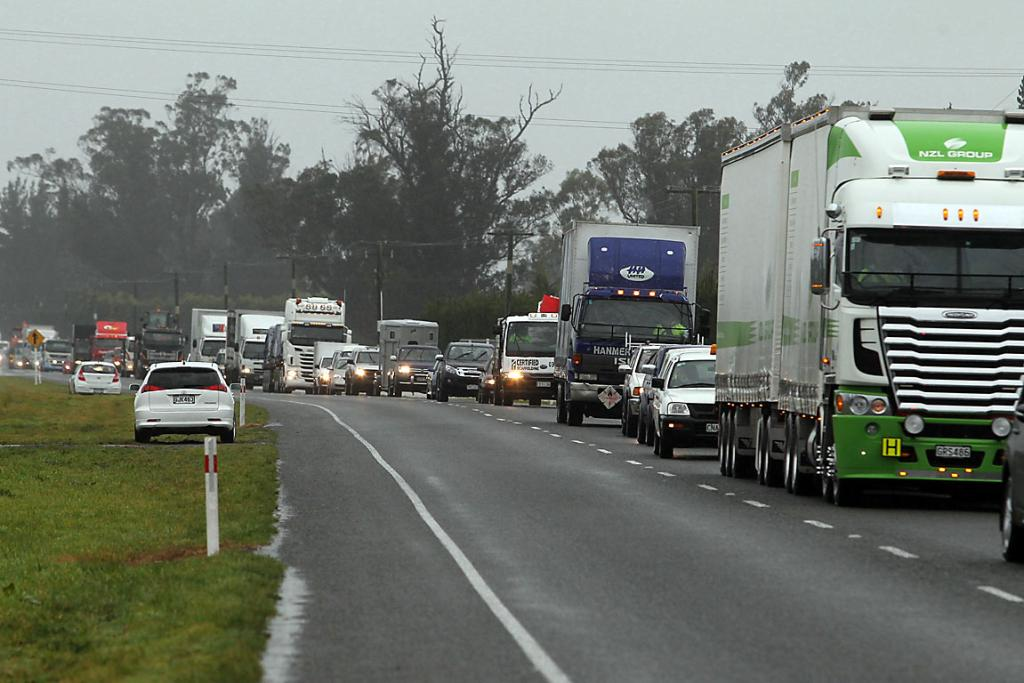 SLOW-MOVING: Traffic jams are forming for those heading north on SH1 due to flooding.