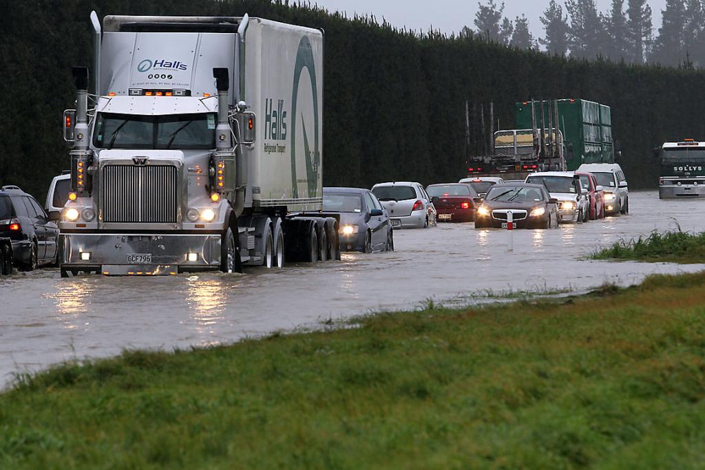 SH1 closed due to flooding