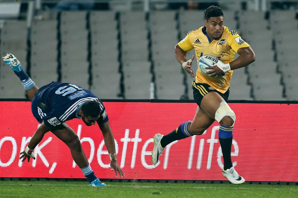 The Hurricanes Julian Savea gets away from Blues Lolagi Visinia.