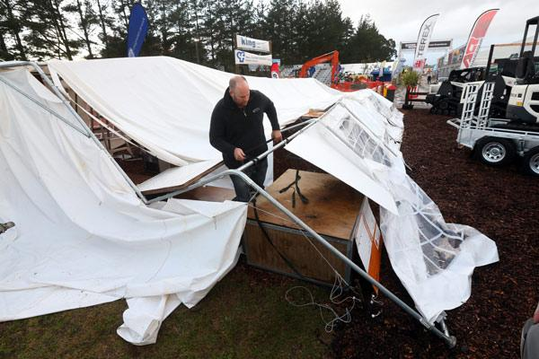 WINDY START: Kris Fannon, from Cambridge, fixed a tent on the Contractors Federation site.