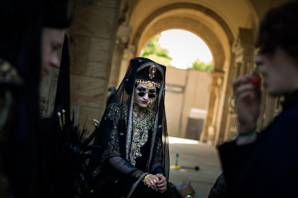 Revellers sit on the steps of the crematorium at the southern cemetery.