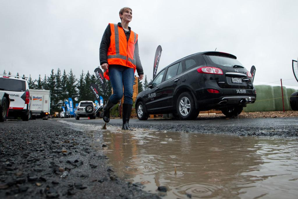 Josie Yockney wears her trusty gumboots to get through wet conditions on the eve of the 2014 National Fieldays at Mystery Creek.
