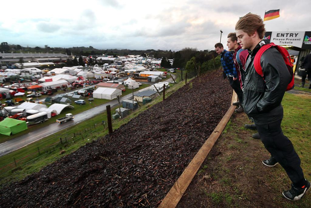 Leaning into the wind from a bank above the National Agricultural Fieldays site are, from right, Matamata lads Taylor Green, 19, Zach Bell, 18 and Daniel Phillips, 20.