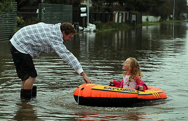 MAKING THE MOST: Absinthe Lucas and her dad, Jamie, have fun in the remnants of floodwater in Akaroa St.