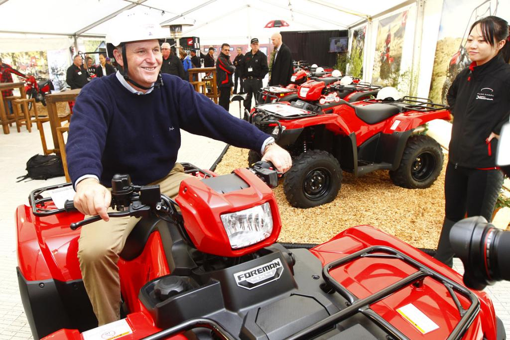 Prime Minister John Key tries out a Honda quad bike at the National Agricultural Fieldays at Mystery Creek.