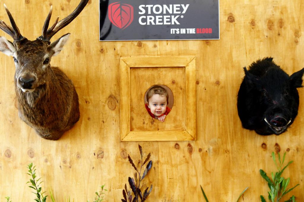 Korey Knudsen, 18 months old, tries out an interesting display at the Stoney Creek site at the National Agricultural Fieldays at Mystery Creek.