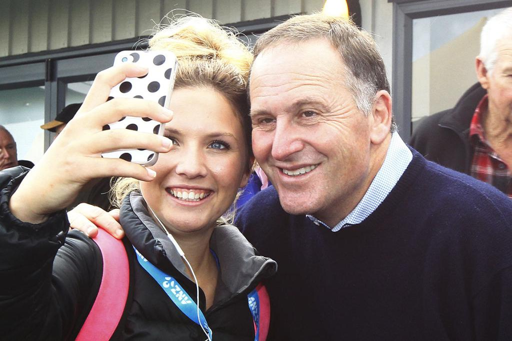 Holly Duggan gets a pic to remember with Prime Minister John Key at the National Agricultural Fieldays at Mystery Creek.