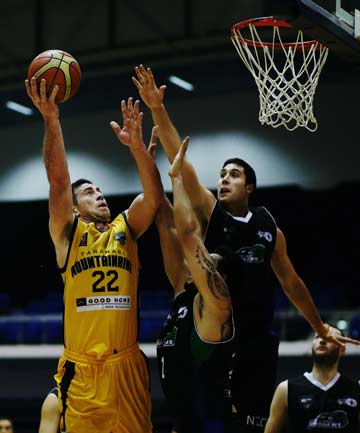 UP AND IN: Taranaki's Aaron Bailey-Nowell attempts to shoot over the Rangers' Tohi Milner-Smith during their NBL game at Trusts Stadium.