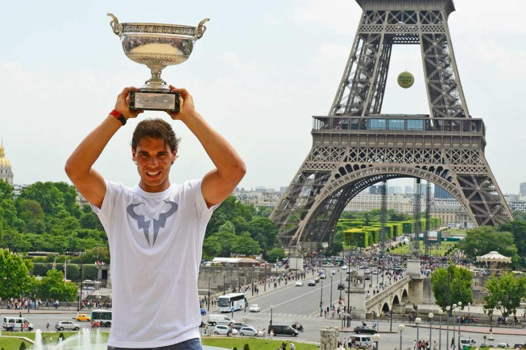 Rafa Nadal with the French Open trophy at the Eiffel Tower.