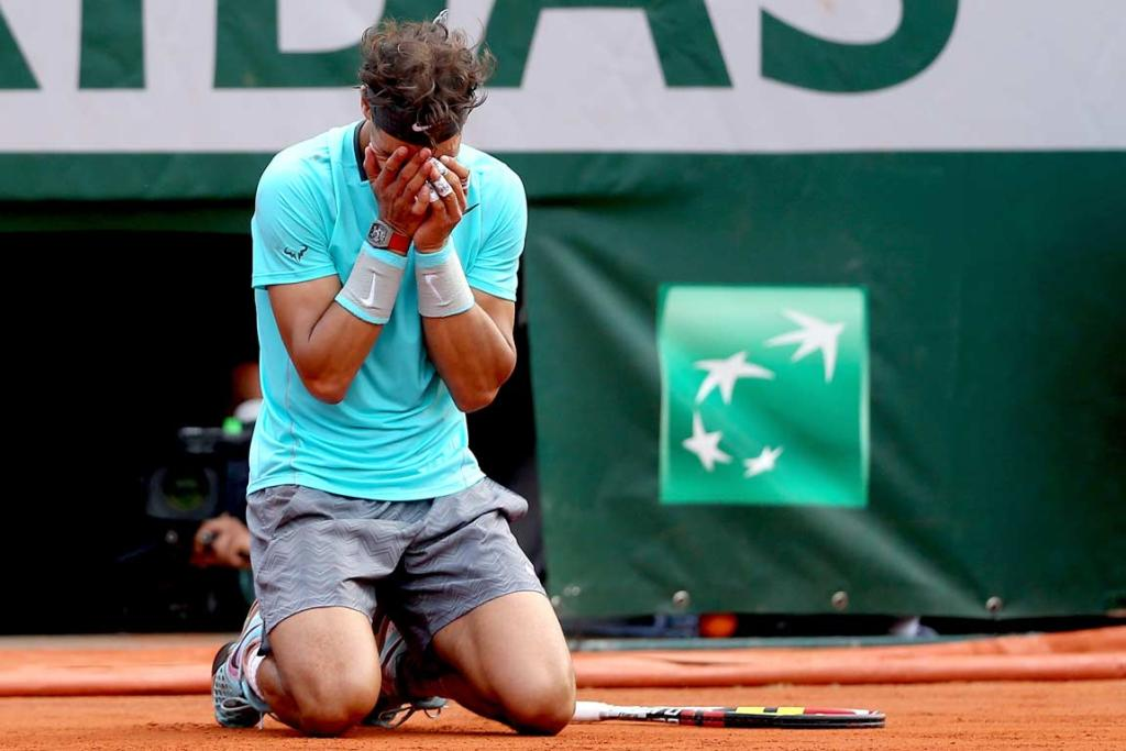 Rafa Nadal drops to his knees after winning his ninth French Open title.