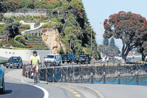 BUSY:  A cyclist, pedestrians, and vehicles share Rocks Road.