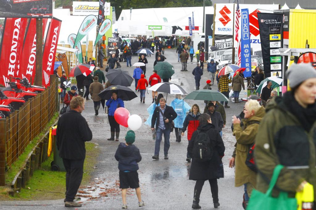 Gumboots and umbrellas were necessary fashion accessories on day two of the 2014 National Fieldays at Mystery Creek.