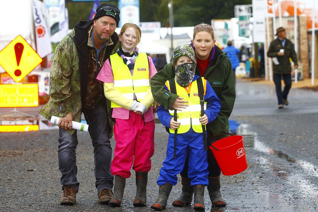 Shane, Aimee, Tommy and Michelle Lawson from Okaihau Bay of Islands are dressed for the inclement weather at the 2014 National Fieldays at Mystery Creek.