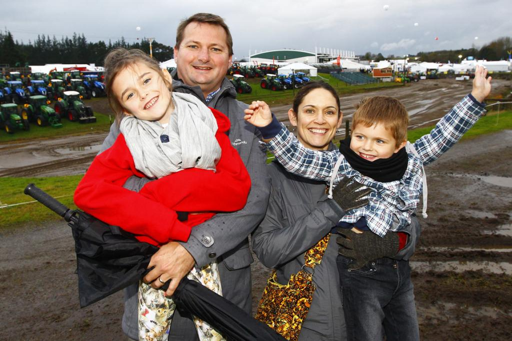 Sam, Nathan, Amanda and Maxwell Flowerday of Tauranga at dressed for the conditions at the 2014 National Fieldays at Mystery Creek.