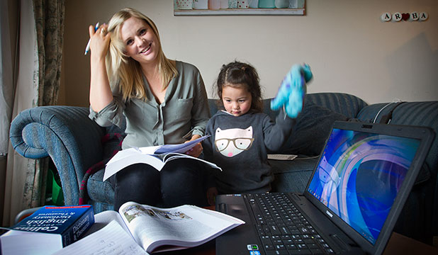 MOTIVATED: Massey University third-year student Lizi Guest, 23, with her daughter Amelia, 2. Guest welcomes the Government's announcement that changes will encourage sole parents into higher study.