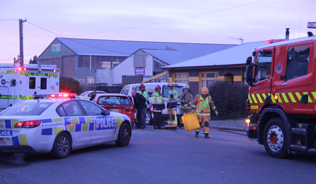 COLLISION: Emergency services workers had to cut a man from a car after a two-car crash.