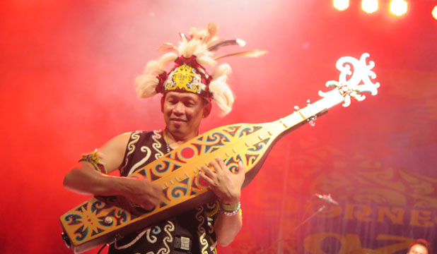 ALL THAT JAZZ: Lead guitarist with YK Samarinda, an ethnic jazz band from East Kalimantan, has his centrestage moment.