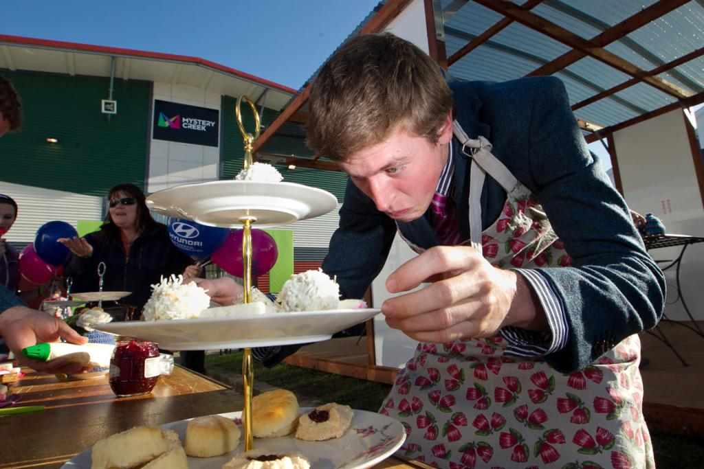 Rural bachelor contestants compete in the high tea competition at the 2014 National Fieldays.