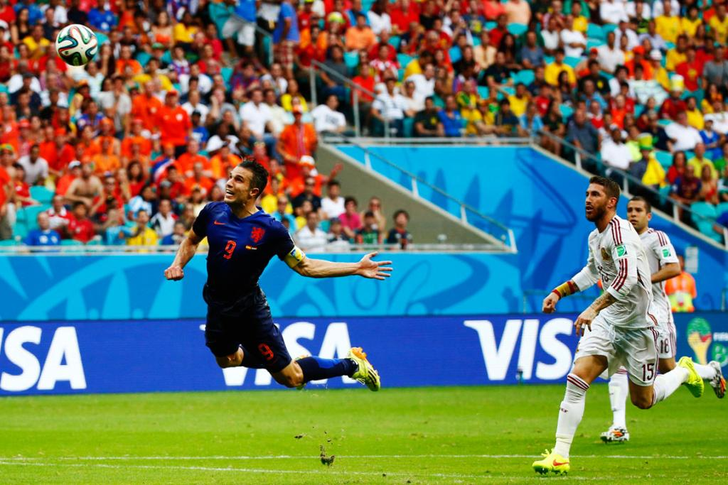 Robin van Persie heads the ball to score against Spain.