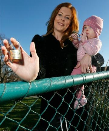 CAMPAIGNER: Kymberly Widley and her daughter Vianne with locks  carrying  messages of love on the bridge.