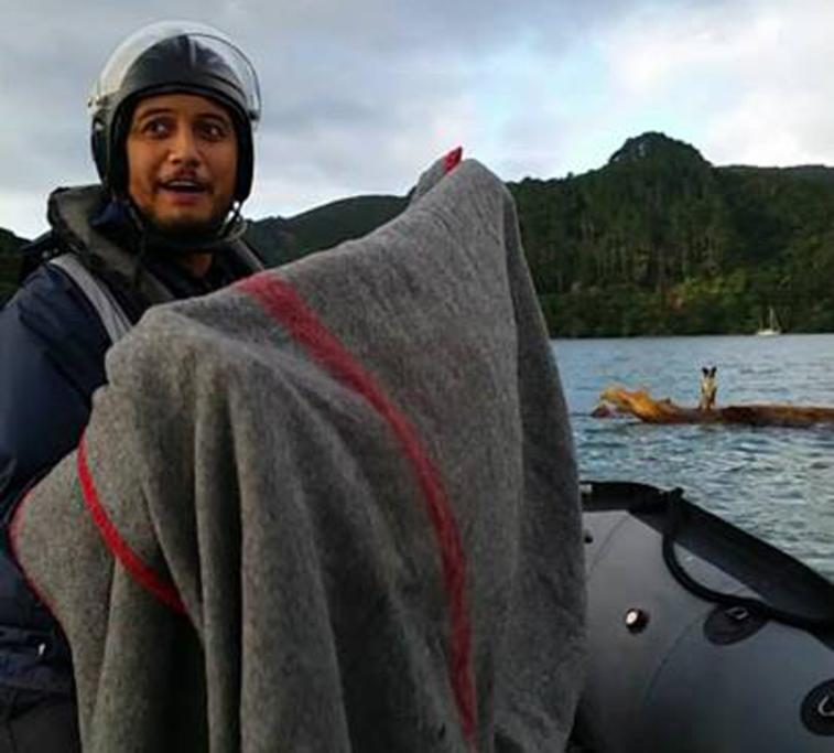 Filipe (Sione) Latu prepares to welcome the dog with a dry blanket.