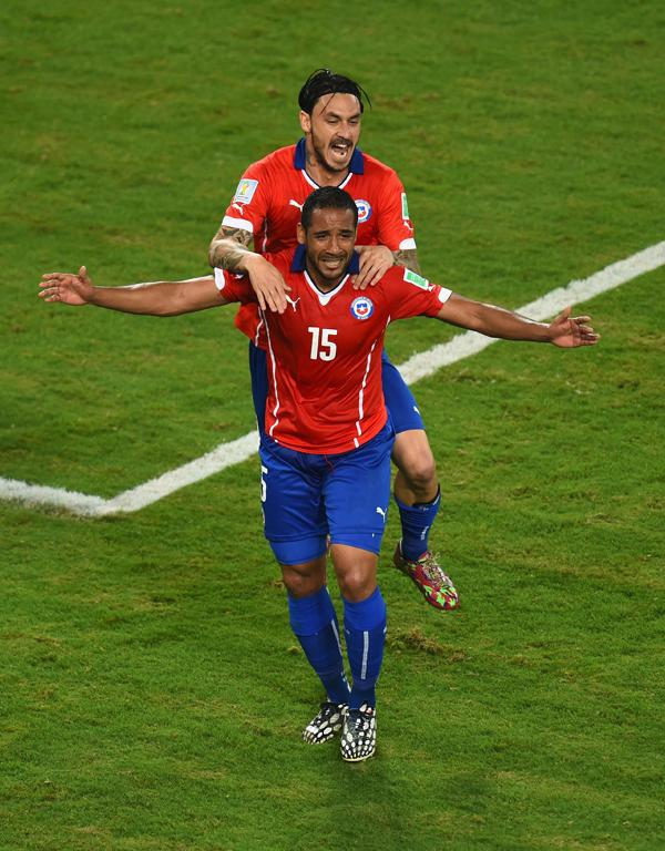Jean Beausejour celebrates scoring Chile's third goal with Mauricio Pinilla.