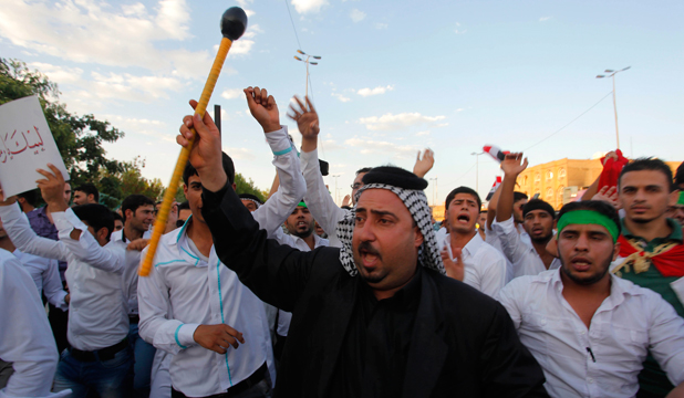 IRAQ UNREST: People shout slogans in support for the call to arms by Grand Ayatollah Ali al-Sistani.