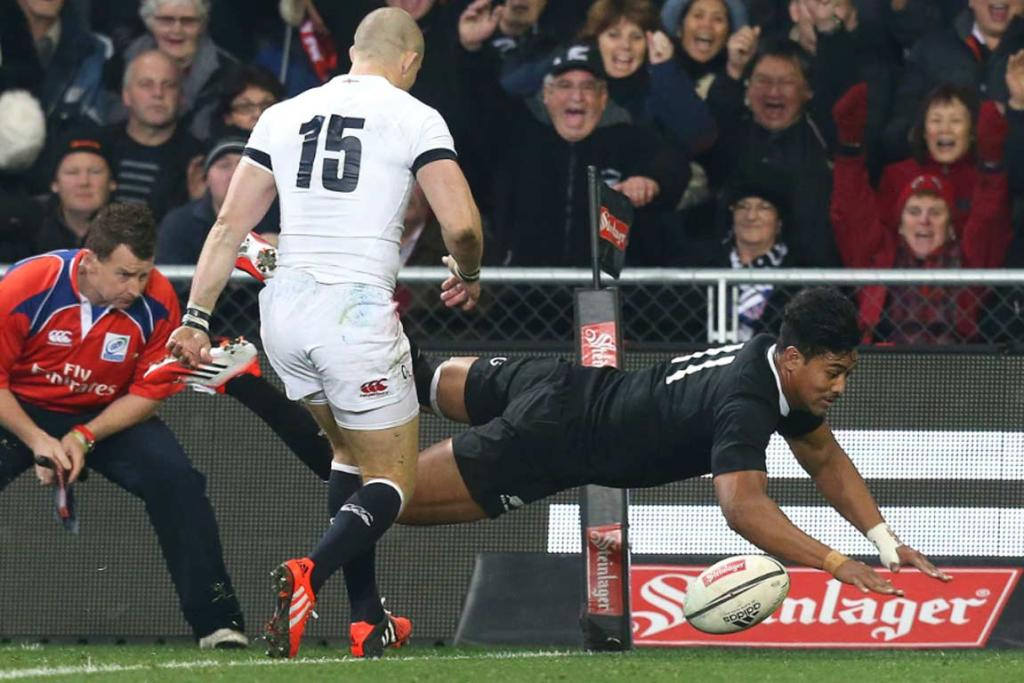 Julian Savea dives over to score in the second half, giving the All Blacks an 18-13 lead.