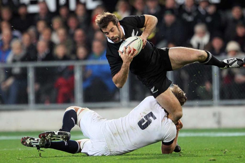 Conrad Smith is unable to break free of England lock Geoff Parling.