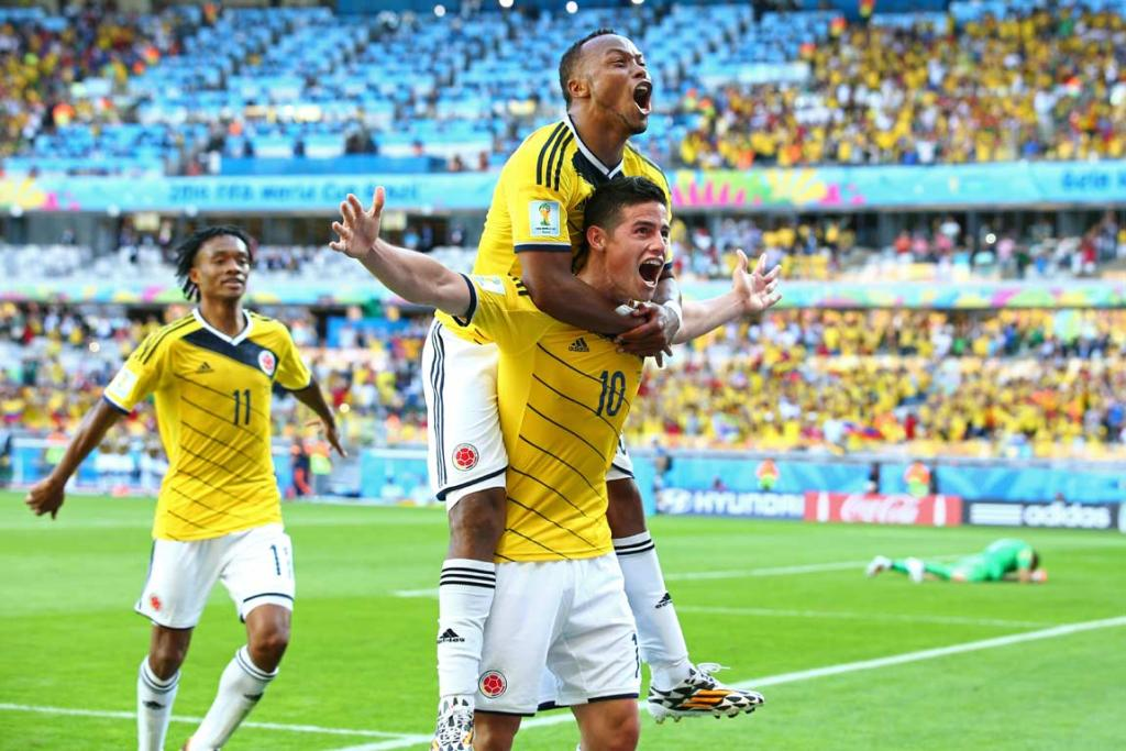 James Rodriguez (bottom) celebrates Colombia's third goal against Greece.