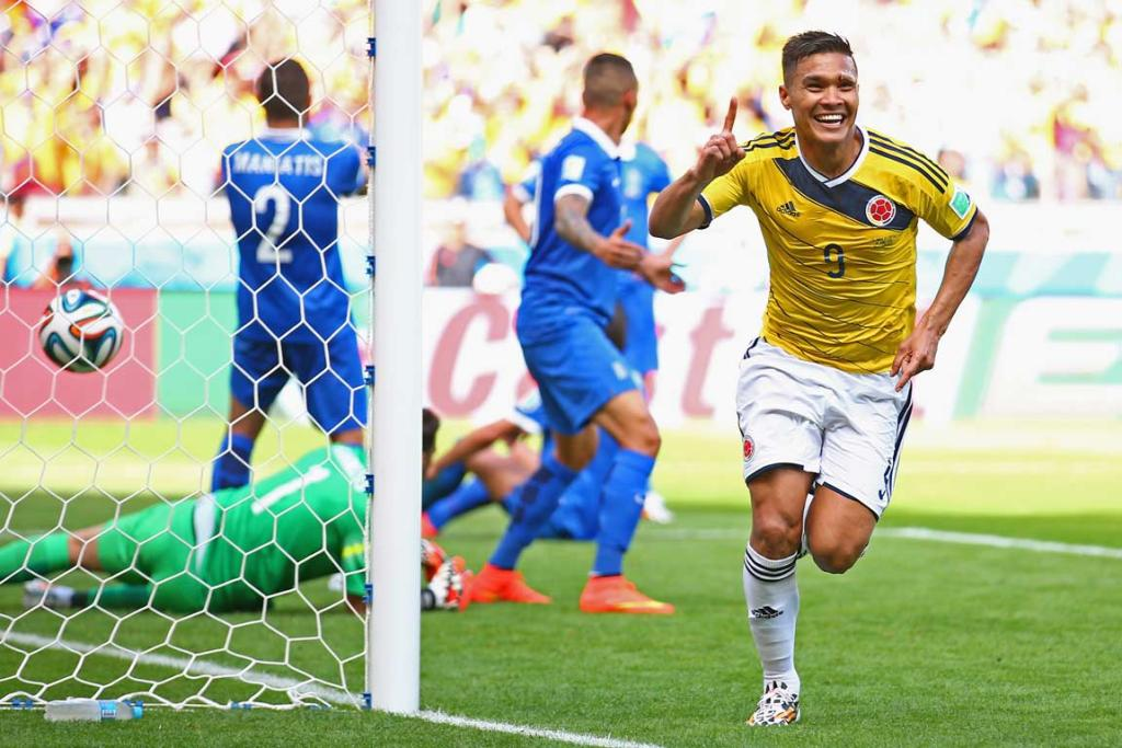 Teo Gutierrez celebrates Colombia's second goal in a 3-0 rout of Greece in Belo Horizonte.