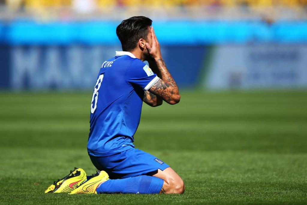 Greece's Panagiotis Kone reacts after missing an open shot.