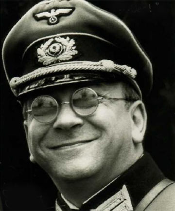 Sam Kelly as Captain Hans Geering in 'Allo 'Allo.