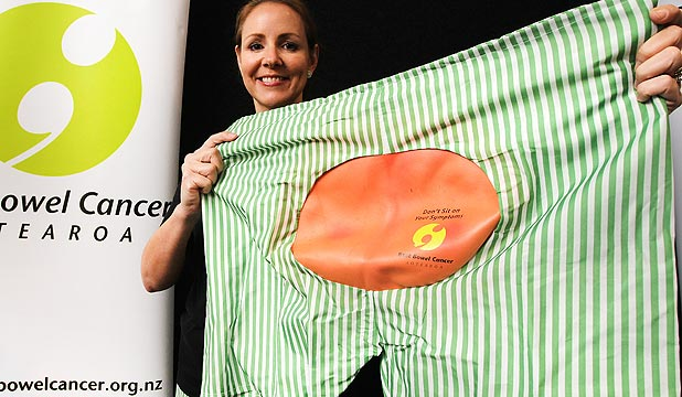 Megan Smith, chief executive of Beat Bowel Cancer Aotearoa, shows off a pair of