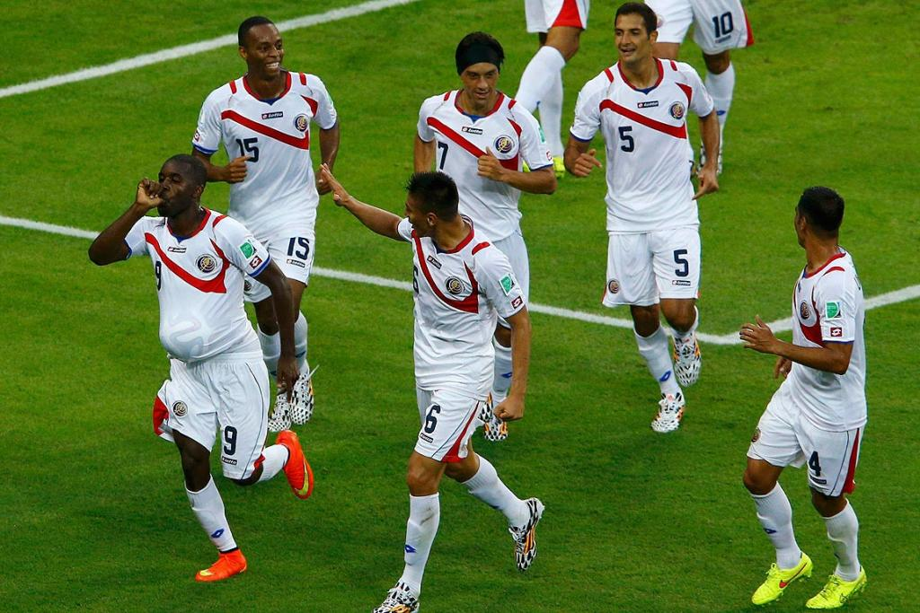 Costa Rica's Joel Campbell celebrates with teammates after scoring a goal against Uruguay during their Group D match.