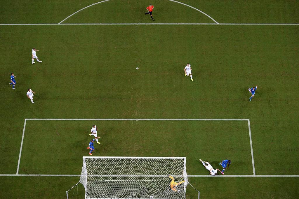 Mario Balotelli of Italy scores his team's second goal on a header past Gary Cahill and goalkeeper Joe Hart of England during the Group D match.