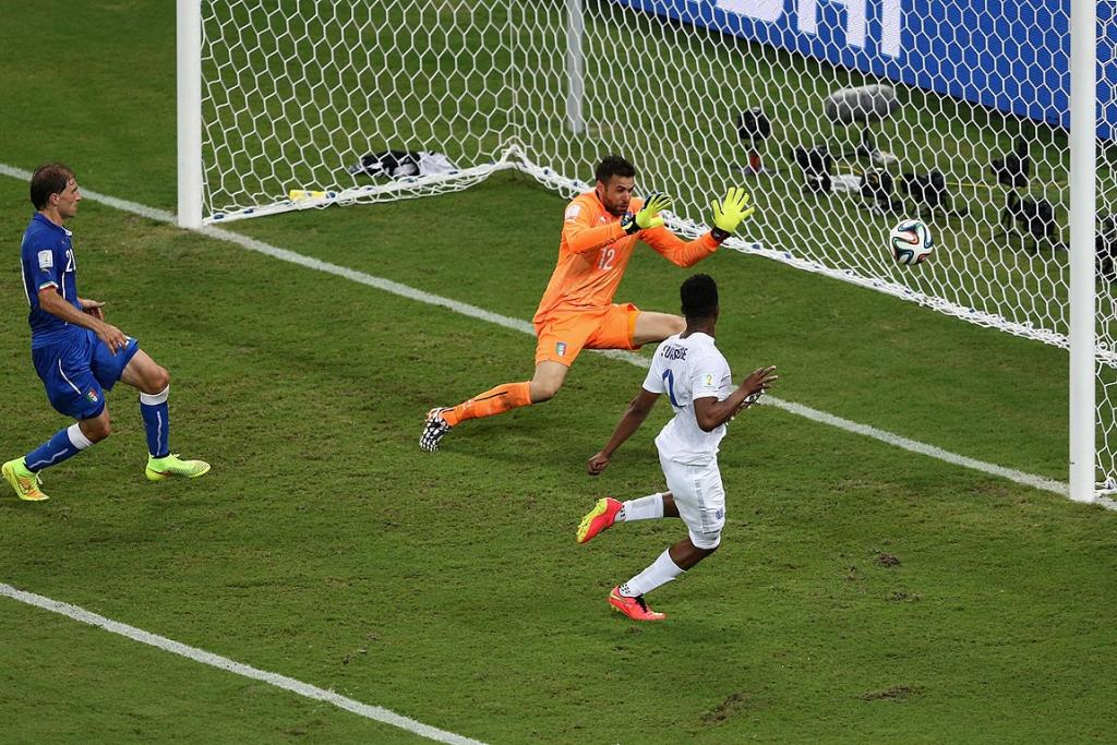 Daniel Sturridge of England shoots and scores his team's first goal past Salvatore Sirigu of Italy.
