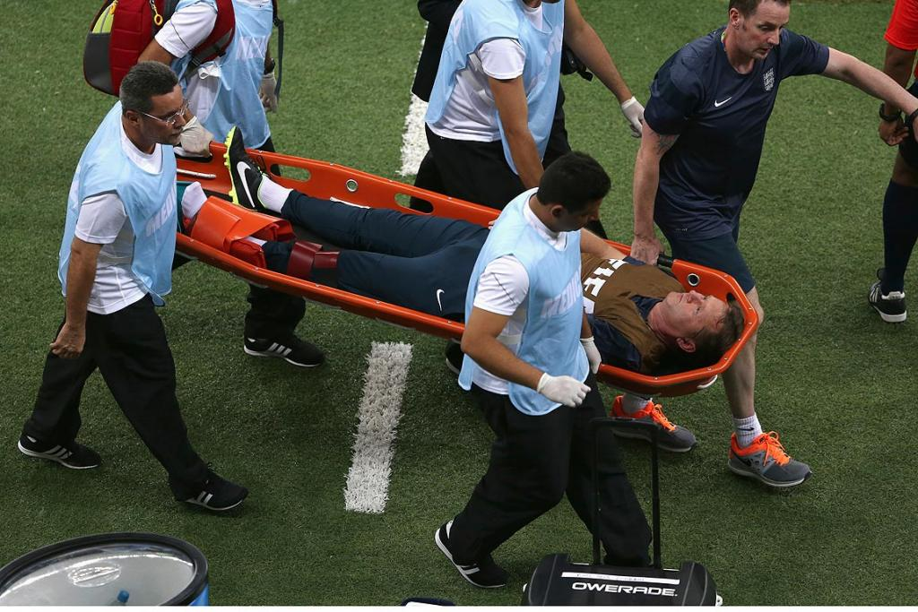 England trainer Gary Lewin is stretchered off the field after a leg injury during the Group D match between England and Italy.