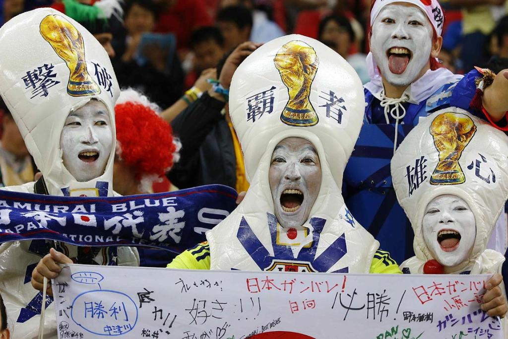 Supporters of Japan cheer during their 2014 World Cup Group C soccer match against Ivory Coast.