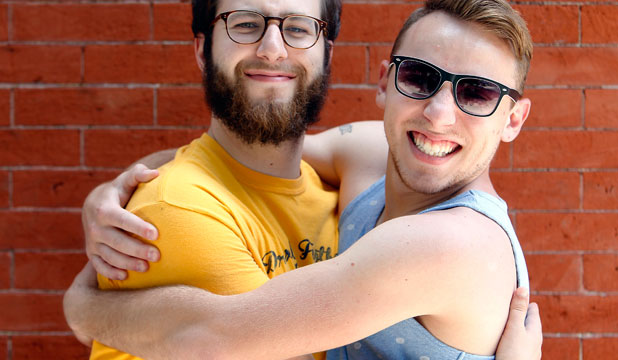 HUG IT OUT: Joey Pasko, right, and friend Lucas Quagliata, both 24, aren't afraid to hug. The rise in hugging can be directly traced to declines in homophobia, a sociologist says.
